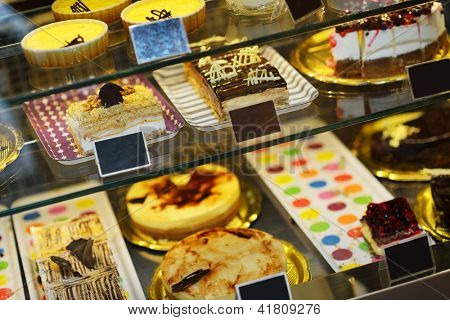 Background filled with colorful cakes and desserts with fresh fruits