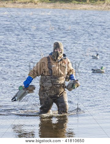 Duck hunter with decoys