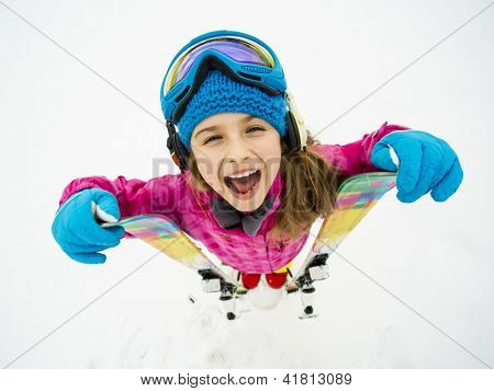 Skiing, winter sports, winter fun - portrait of young skier