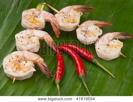 fresh shrimp on a green banana