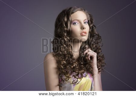 Pretty Brunette With Curly Hairturned Of Three Quarters