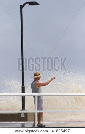 Brisbane, Australia - January 28 : Unidentified Resident Takes Snapshot Of Tidal Surge From Ex Tropi