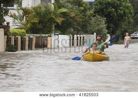 Brisbane, Australia - January 28 : Unidentified Residents Taking Canoe Rides In Flooded Street From