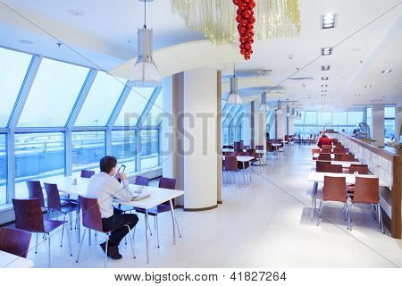 MOSCOW - DECEMBER 20: People sit in cafe in skyscraper North Tower of business center Moscow City on December 20, 2011 in Moscow, Russia. North Tower consists of 27 floors.
