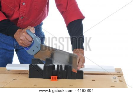 Woodworker With Saw And Miter Box