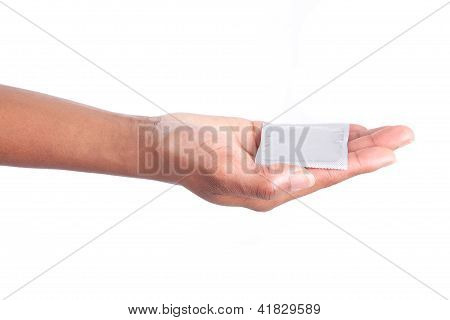 Safe Sex Concept. African Woman Hand With Condom