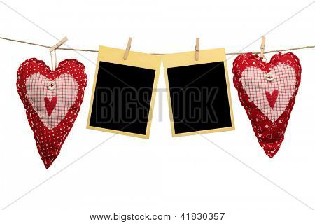 Homemade hearts with blank cards hanging on clothes line.
