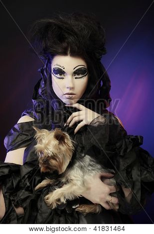 elegant dark queen with little dog