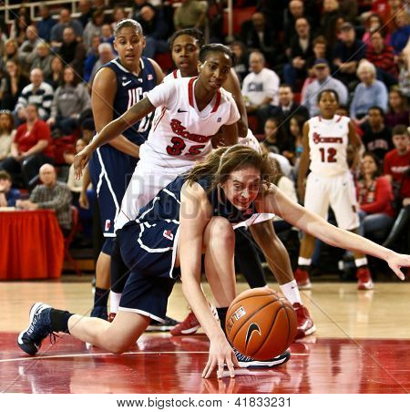 JAMAICA-FEB 2: Connecticut Huskies forward Breanna Stewart (30) and St. John's Red Storm guard Shenneika Smith (35) battle for the ball at Carnesecca Arena on February 2, 2013 in Jamaica, New York.
