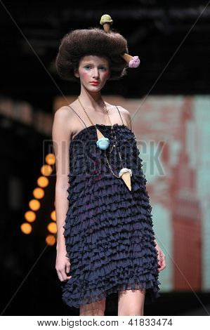 ZAGREB, CROATIA - OCTOBER 19: Fashion model wears clothes made by MBorna & Fils at 'Croaporter' fashion show, on October 19, 2012 in Zagreb, Croatia.