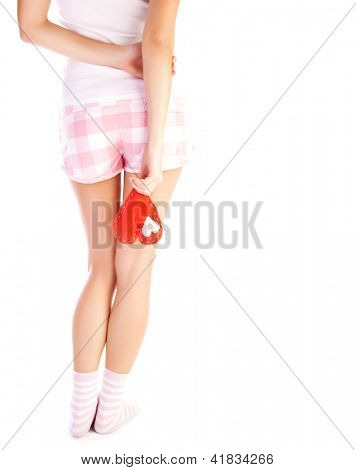 Picture of young woman with red heart-shaped soft toy standing rear view isolated on white background, one-sided love, lonely girl, i had a crush on you, heartbroken, parting in relationship