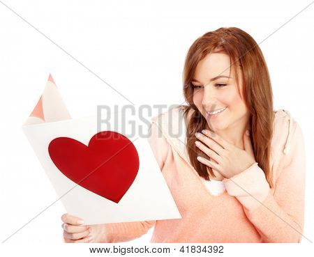 Image of happy beautiful female reading romantic greeting card with big red heart, attractive brunette woman got love letter, cheerful girl expressing happiness on Valentine day, in love concept
