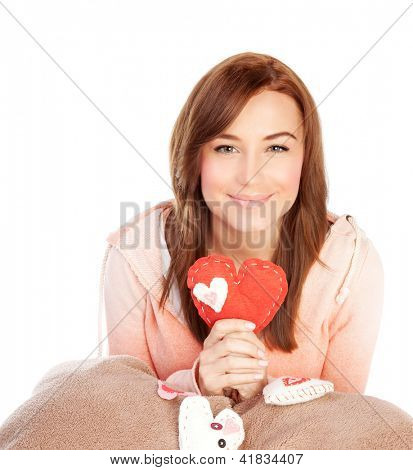Picture of cute young lady with red handmade heart-shaped soft toy isolated on white background, Valentine day, romantic gift, lovely female, 14 of february, love and happiness concept