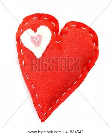 Picture of beautiful handmade red heart-shaped soft toy isolated on white background, sew homemade gift for Valentines day, cute present for romantic holiday, love concept