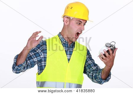 Construction worker yelling at an alarm clock