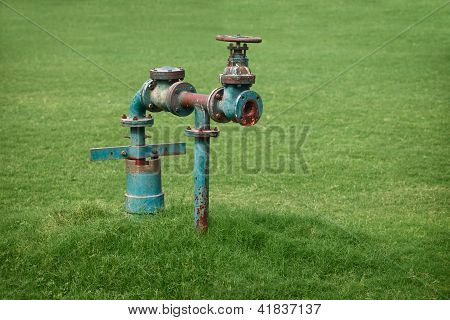 Water Pipe On Green Grass Meadow