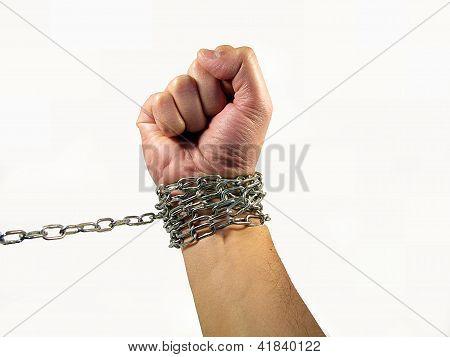 acorrentado a mão do conceito de estar preso a algo e escravidão