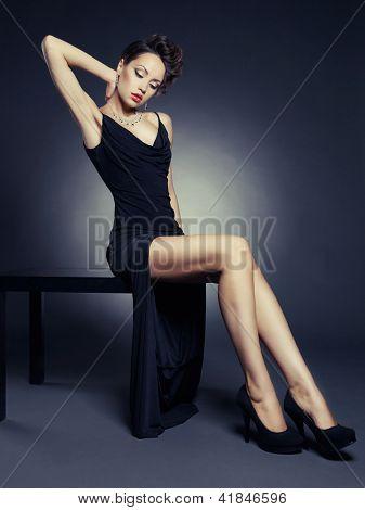 Fashion photo of beautiful lady in elegant evening dress