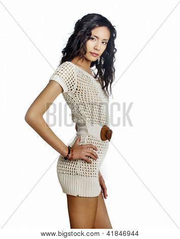 Beautiful young woman wearing knit dress.