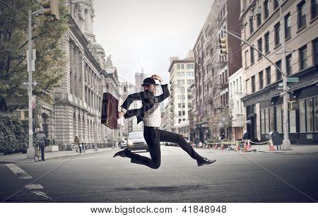 stressed businessman runs through the city
