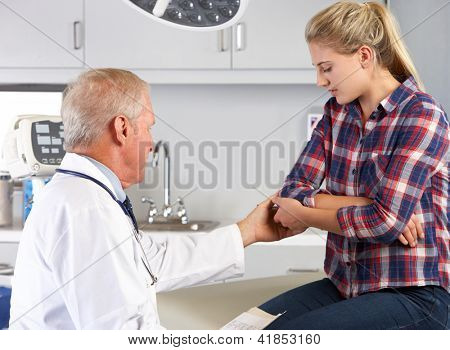 Teenage Girl Visits Doctor's Office With Elbow Pain