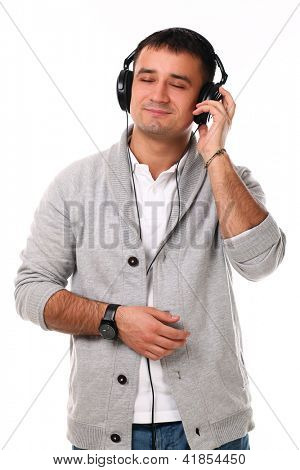 Young handsome man with headphones isolated over white background