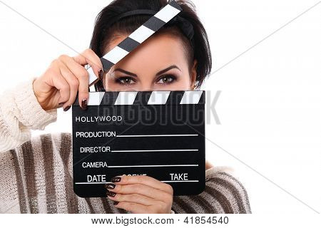 Young happy woman holding a clapboard isolated over white background