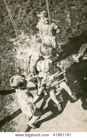 Vintage photo of children playing outdoor (early fifties)