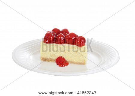 Isolated slice cherry cheesecake