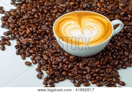 Latte art, coffee in coffee beans background