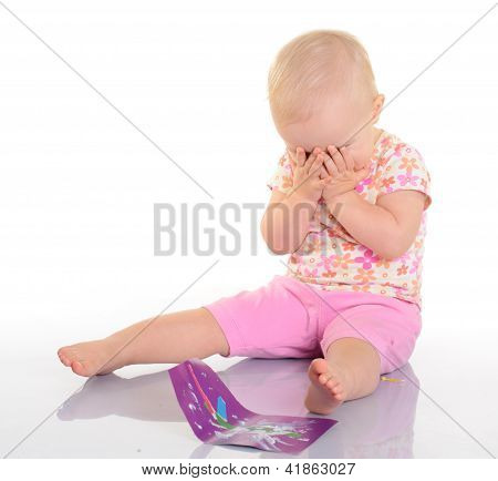 Baby Playing With A Picture On White Background