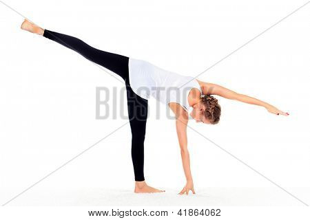 Slender young woman doing yoga exercise. Isolated over white background.