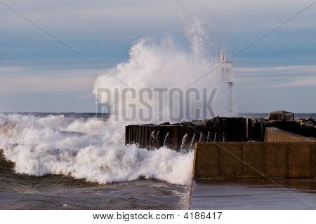 Great Lakes Waves Crashing Into Harbor Light
