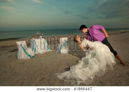 Romantic young couple dancing on the beach