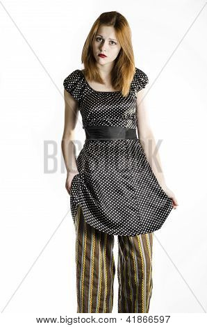 Girl in dress and striped pants