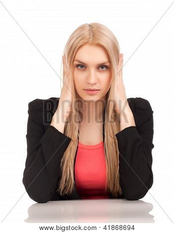 Business woman covering her ears