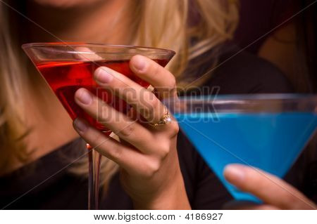 Female Hands Holding A Martini