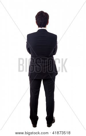 Young business man from the back waiting for something over a white background
