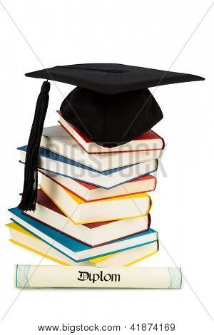 a mortarboard on a pile of books, symbolic photo for education and skills