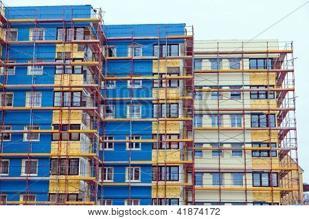 a residential building is being renovated. for energy saving insulation and heat protection.