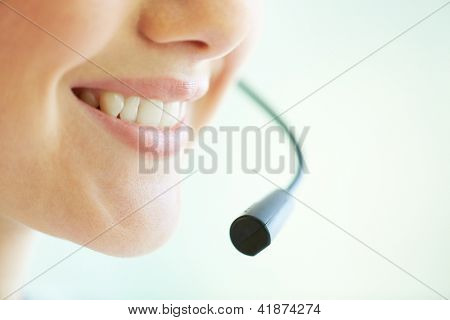 Smiling telemarketing operator giving a consultation concerning the product