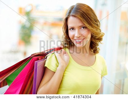 Portrait of a shopping girl with flirty look