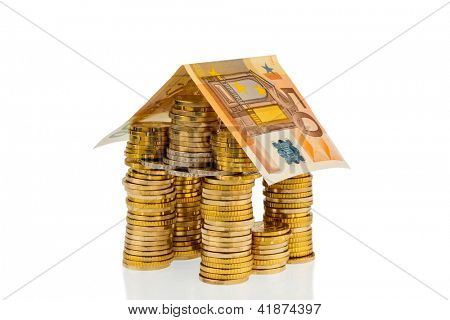 a house made of coins and banknotes. photo icon for construction and home loans