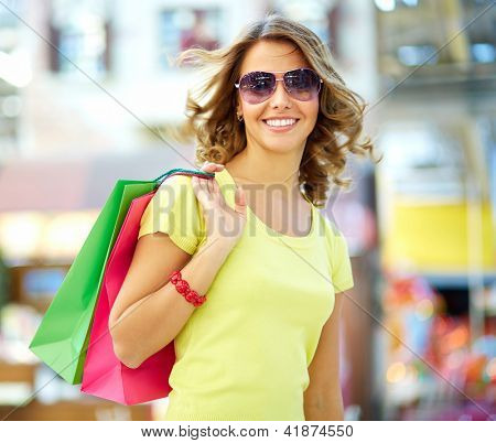 Portrait of a stylish shopaholic hunting for sprees and sales