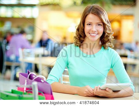 Portrait of a smiling young woman enjoying her shopping day