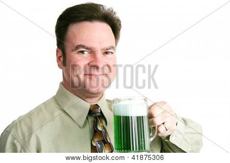 Handsome Irish American man celebrating St Patricks day with a mug of green beer.  Portait over white.