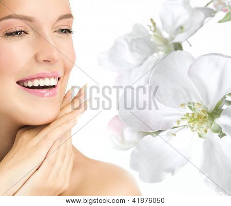 portrait of attractive  caucasian smiling woman blond isolated on white studio shot  toothy smile face head and shoulders hands nails flowers