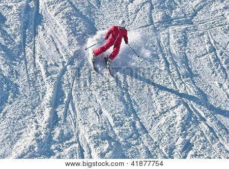 A Boy Is Skiing At A Ski Resort