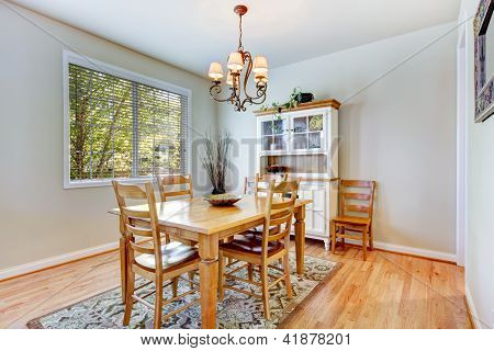 Natural Grey Dining Room With Wood Table And Cabinet.
