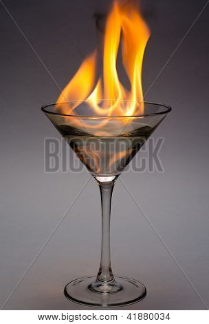 Glass containing a hot drink made of liquor and fire